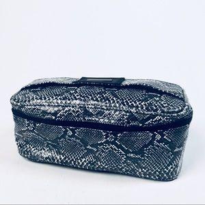 Snake Embossed Makeup Bag by Leif